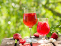 Fruit lemonade or sangria refreshing in glasses selective focus Stock Image
