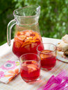 Fruit lemonade or sangria refreshing in pitcher and glasses selective focus Stock Image