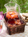 Fruit lemonade or sangria refreshing in pitcher and glasses selective focus Royalty Free Stock Photos