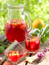 Fruit lemonade or sangria refreshing in pitcher and glasses selective focus Royalty Free Stock Images