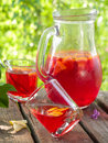 Fruit lemonade or sangria refreshing in pitcher and glasses selective focus Stock Photos