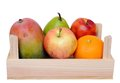 Fruit mango apple pear orange peach in crate isolated on white Royalty Free Stock Photography
