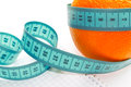Fruit measuring tape to body white background Royalty Free Stock Photos