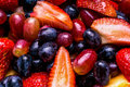 Fruit medley strawberries and grapes Royalty Free Stock Image