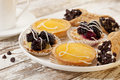 Fruit mini tarts and coffee Royalty Free Stock Photos