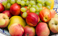 Fruit mix apples grapes peaches melon in a bowl Royalty Free Stock Photo