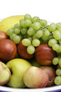Fruit mix apples grapes peaches melon in a bowl Stock Photo