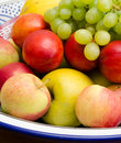 Fruit mix apples grapes peaches melon in a bowl Royalty Free Stock Image