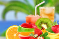Fruit mix and cocktail on a beach background Stock Photos