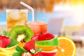 Fruit mix and cocktail on a beach background Royalty Free Stock Photos