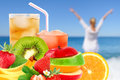 Fruit mix and cocktail on a beach background Stock Photo