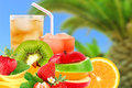 Fruit mix and cocktail on a beach background Stock Images