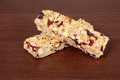 Fruit and nut granola bars on wood Royalty Free Stock Image