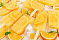 Fruit orange ice lolly on ice cubes Royalty Free Stock Photo