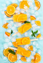 Fruit orange ice lolly on light blue background. Royalty Free Stock Photo