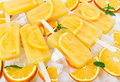 Fruit orange ice lolly with slices of orange Royalty Free Stock Photo