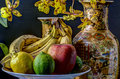 Fruit and orchid still life with flowers vases Stock Photography