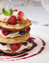 Fruit pancake crumpets with raspberry sauce whipped curd cheese and roasted almonds Stock Image