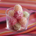 Fruit paste truffles coated in grated coconut Stock Photos