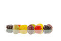 Fruit pastille gumdrops, reflected Royalty Free Stock Photos