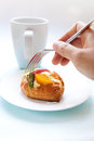 Fruit pastry with cup of hot beverage Royalty Free Stock Photos