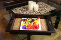 Fruit plate on coffee table a sitting bamboo mat with candles glass Stock Photos