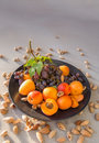 Fruit plate with grapes, apricot and almond.