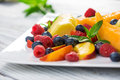 Fruit plate white platter on wooden table background Royalty Free Stock Photos