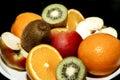 Fruit on a platter Oranges apples kiwi Royalty Free Stock Photo