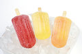 Fruit popsicle colorful in a bowl of ice Stock Photos