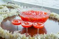 Fruit punch with ice served in beautiful big glass bowl Royalty Free Stock Photos