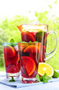 Fruit punch in pitcher and glasses Stock Images