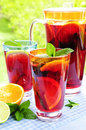 Fruit punch in pitcher and glasses Stock Photography