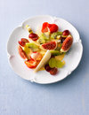 Fruit salad assorted fruits on a white plate Royalty Free Stock Image