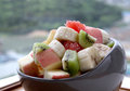 Fruit salad a bowl of mixed fruits Stock Photography