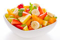 Fruit salad in the bowl mixed on white background Stock Photography