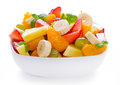 Fruit salad in the bowl mixed on white background Royalty Free Stock Image