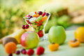 Fruit salad with fresh fruit prepared organic fruits on a table Royalty Free Stock Image