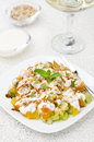 Fruit salad with nuts, yogurt and mint, vertical Royalty Free Stock Images