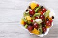 Fruit salad of oranges, grapes. pears, kiwi horizontal top view Royalty Free Stock Photo