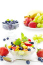 Fruit salad with peaches blueberries grapes strawberries and bananas Stock Photos