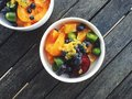 Fruit salad: plums, apricots, kiwi berries, oranges, blueberries, passionfruit Royalty Free Stock Photo