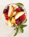 Fruit salad with strawberry apple melon grapes and blueberries Stock Image