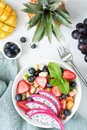 Fruit salad with tropical fruits in a bowl Royalty Free Stock Photo