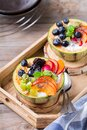 Fruit salad with yogurt in carved melon cantaloupe bowl Royalty Free Stock Photo