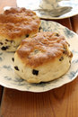 Fruit scones and afternoon tea Royalty Free Stock Photo