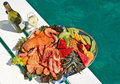 Fruit and seafood platter with wine Stock Photography