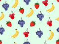 Fruit seamless pattern with bananas, cherries, strawberries and grapes. Royalty Free Stock Photo
