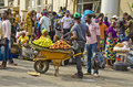 Fruit seller a hawker sells fruits on a wheelbarrow in lagos Royalty Free Stock Photos