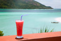 Fruit shakes over blue sea Royalty Free Stock Images